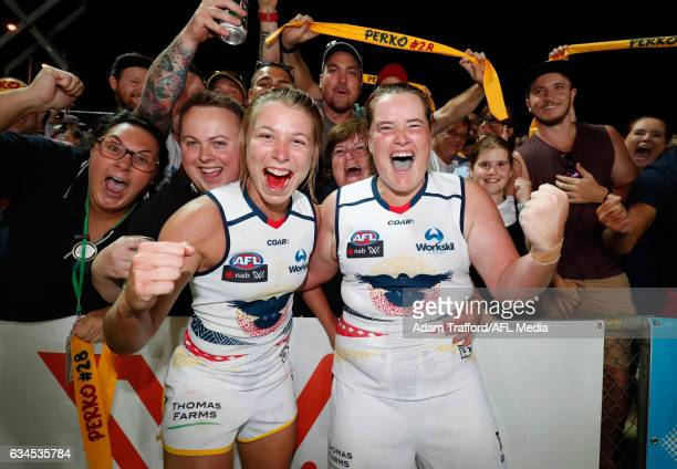 Kellie Gibson and Sarah Perkins of the Crows celebrate with fans during the 2017 AFLW Round 02 match between the Western Bulldogs and the Adelaide...