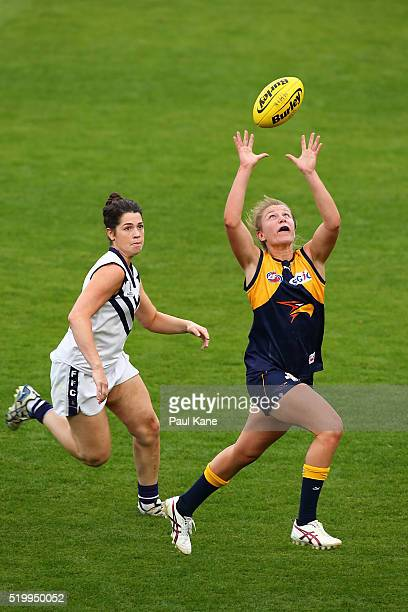 Kellie Gibson of the Eagles marks the ball agaisnt Eliza Gelmi of the Dockers during the Women's AFL Exhibition Match between the West Coast Eagles...