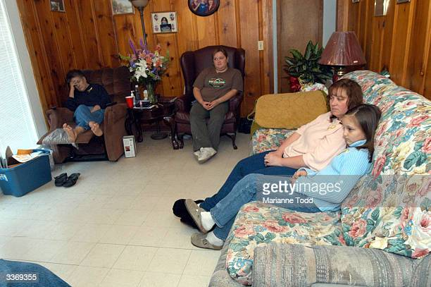 Kellie Hamill awaits word about her husband Thomas Hammill at the family home with her daughter Tori and her motherinlaw Phyllis Hamill watches...