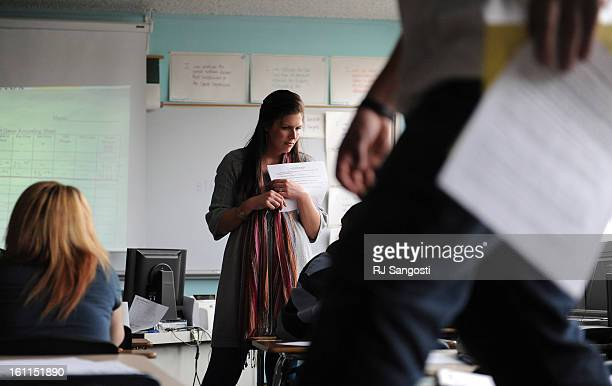 Kellie Lisi, center, teaches a lesson plan on the stock market during humanities class at Mapleton Expeditionary School of the Arts in Thornton. RJ...