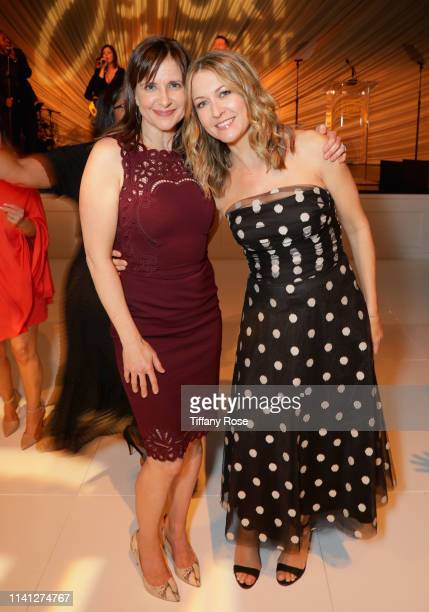 Kellie Martin and Ali Hillis attend the Lupus LA 2019 Orange Ball at the Beverly Wilshire Hotel on May 4 2019 in Beverly Hills California