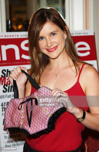 Kellie Martin holding the handbag she donated during Lupus LA InStyle Magazine Present The Old Bags Lupus Luncheon at The Beverly Hills Hotel in...