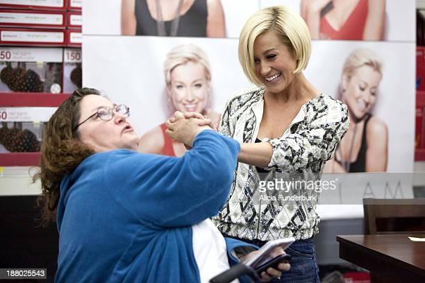 "Kellie Pickler promotes the new album ""The Woman I Am"" at Walmart on November 14, 2013 in Belmont, North Carolina."