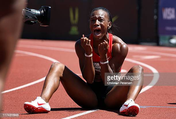 Kellie Wells celebrates after winning the Women's 100 meter hurdles final on day four of the USA Outdoor Track & Field Championships at the Hayward...