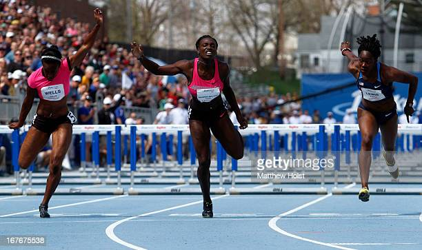 Kellie Wells Dawn Harper and Yvette Lewis of Nike stretch at the finish line in the Women's 100meter Hurdles London Games Rematch at the Drake Relays...