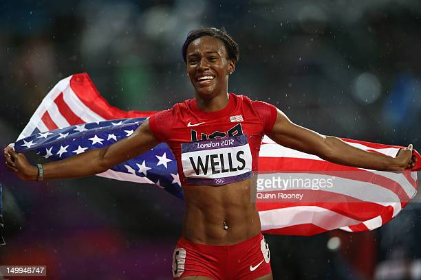 Kellie Wells of the United States celebrates after winning the bronze medal in the Women's 100m Hurdles Final on Day 11 of the London 2012 Olympic...