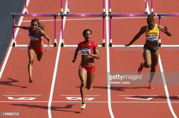 Kellie Wells of the United States finishes ahead of Lina Florez of Colombia and Shermaine Williams of Jamaica after competing in the Women's 100m...