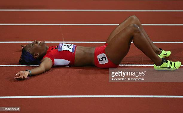 Kellie Wells of the United States lays on the ground after winning the bronze medal in the Women's 100m Hurdles Final on Day 11 of the London 2012...