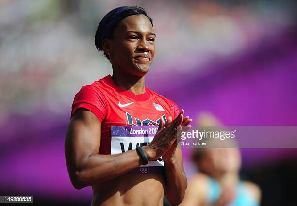 Kellie Wells of the United States looks on after competing in the Women's 100m Hurdles heat on Day 10 of the London 2012 Olympic Games at the Olympic...