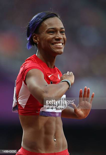 Kellie Wells of the United States reacts after competing in the Women's 100m Hurdles Semifinals on Day 11 of the London 2012 Olympic Games at Olympic...
