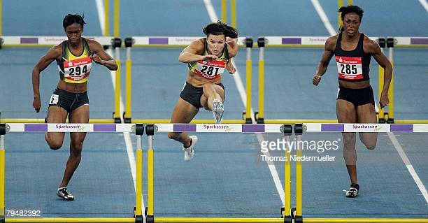 Kellie Wells of the USA, Suzanna Kallur of Sweden and Danielle Carruthers of the USA competes in the 60m hurdles during the Sparkassen Cup 2008 at...