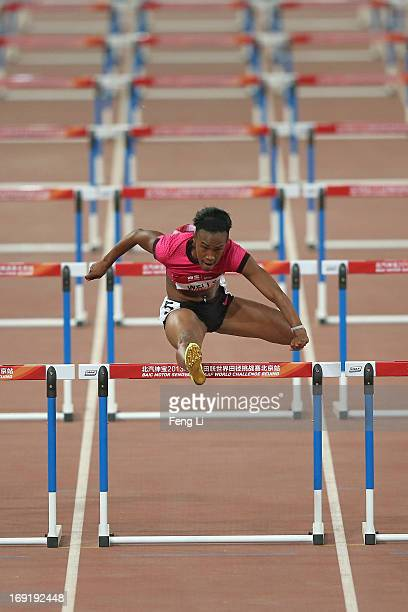 Kellie Wells of United States completes in the Women's 100 Metres Hurdles at National Stadium also known as Bird's Nest during 2013 IAAF World...