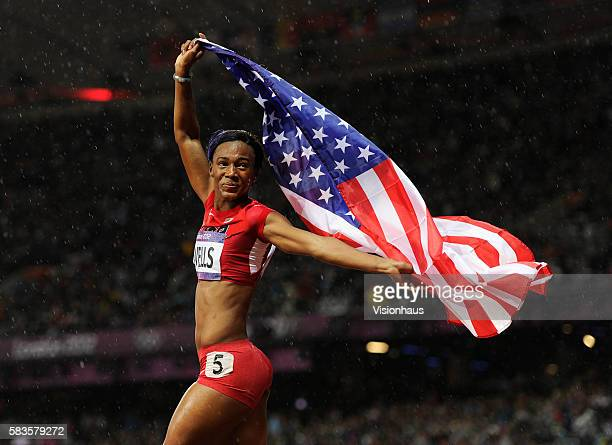 Kellie Wells of USA celebrates her bronze medal in the Womens 100m Hurdles as part of the 2012 London Olympic Summer Games at the Olympic Stadium,...