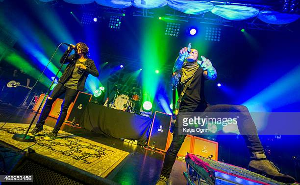 Kellin Quinn and Justin Hills of Sleeping with Sirens perform at O2 Academy Birmingham on April 8 2015 in Birmingham United Kingdom