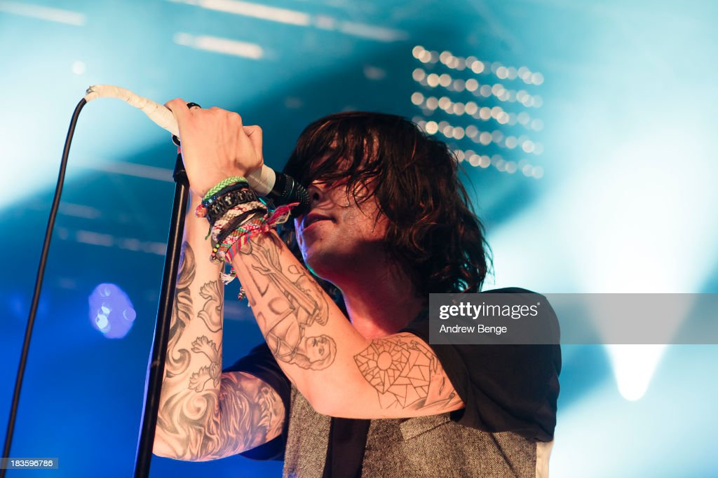 Kellin Quinn of Sleeping With Sirens performs on stage at Manchester Academy on October 7, 2013 in Manchester, England.