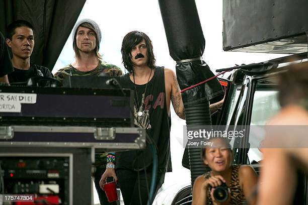 Kellin Quinn of the band Sleeping with Sirens watches the band letlive performs onstage during the 2013 Van Warped Tour at Riverbend Music Center on...