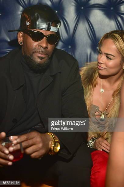 R Kelly and Halle Calhoun attend a Party at Amora Lounge on October 26 2017 in Atlanta Georgia