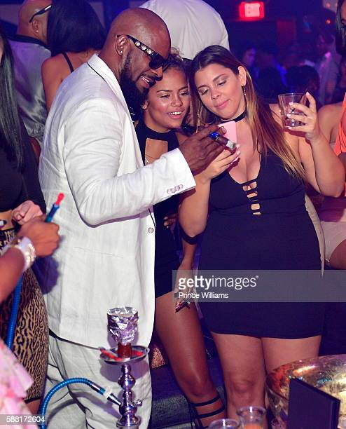 R Kelly and Halle Calhoun attend a party at Gold Room on August 7 2016 in Atlanta Georgia