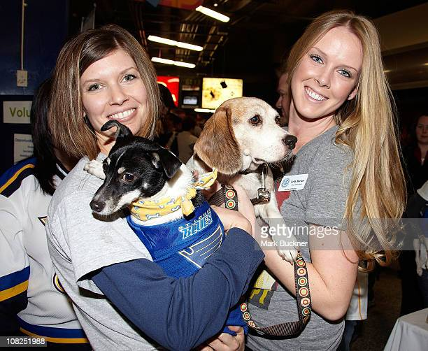 Kelly Backes wife of David Backes of the St Louis Blues and St Charles Humane Society executive director Kim Brown pose with two of the dogs...