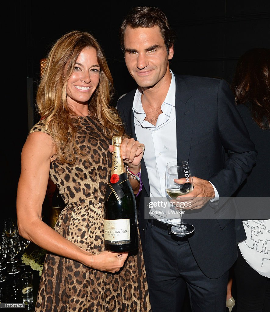 Kelly Bensimon (L) and Professional Tennis Player Roger Federer attend Moet & Chandon Celebrates Its 270th Anniversary With New Global Brand Ambassador, International Tennis Champion, Roger Federer at Chelsea Piers Sports Center on August 20, 2013 in New York City.