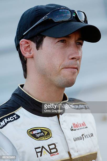 Kelly Bires driver of the Chevrolet walks through the garage area during practice for the NASCAR Nationwide Series Federated Auto Parts 300 at the...