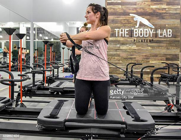 Kelly Bradshaw exercises on Thursday Nov 13 during a preview class at The Body Lab in Leawood Kan The studio which opens in December 2014 offers an...