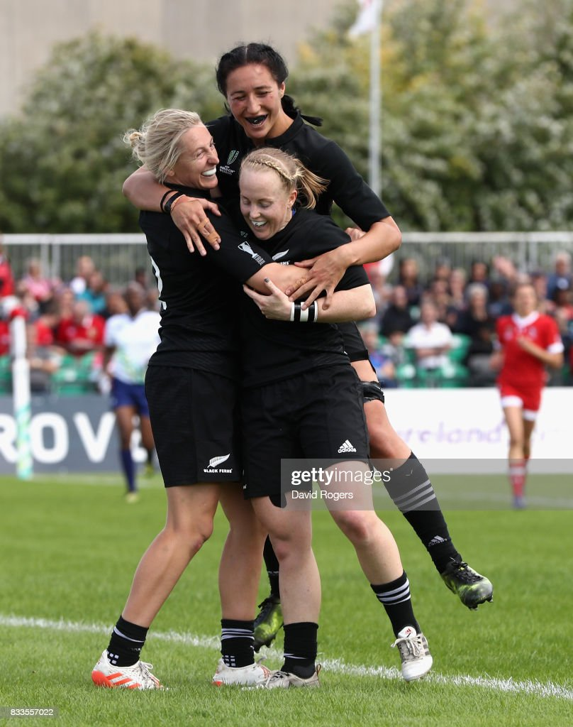 Kelly Brazier of New Zealand Black Ferns (L) is congratulated by team mates Kendra Kocksedge and Sarah Gross after scoring a try during the Women's Rugby World Cup Pool A, match between Canada and New Zealand Black Ferns at Billings Park UCB on August 17, 2017 in Dublin, Ireland.