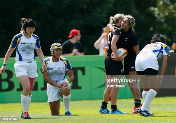 Kelly Brazier of New Zealand is congratulated by teammate Huriana Manuel of New Zealand after scoring a try during the IRB Women's Rugby World Cup...
