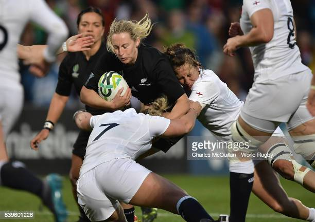 Kelly Brazier of New Zealand is tackled by Marlie Packer of England during the Women's Rugby World Cup 2017 Final between England and New Zealand on...