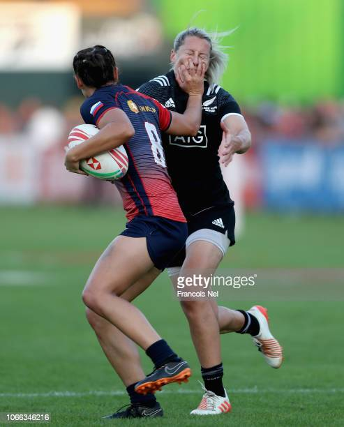 Kelly Brazier of New Zealand tackles Marina Kukina of Russia on day one of the Emirates Dubai Rugby Sevens HSBC World Rugby Sevens Series at The...