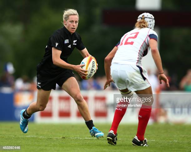 Kelly Brazier of New Zealand takes the ball past Sylvia Braaten of the USA during the IRB Women's Rugby World Cup Pool B match between New Zealand...