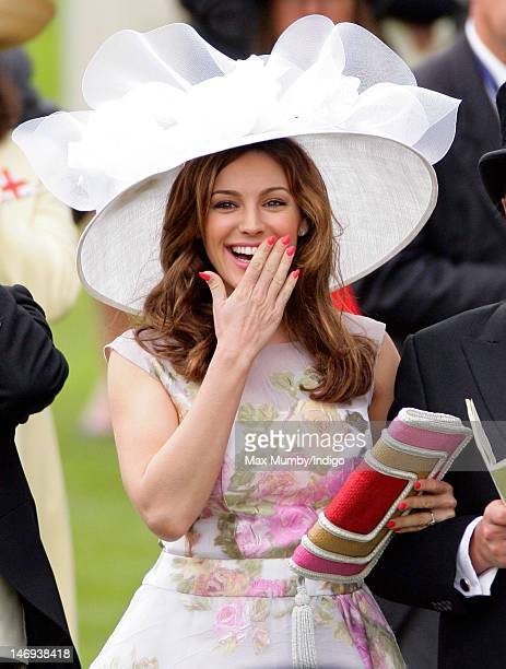 Kelly Brook cheers 'Black Caviar' to victory in the Diamond Jubilee Stakes horse race on day five of Royal Ascot at Ascot Racecourse on June 23 2012...