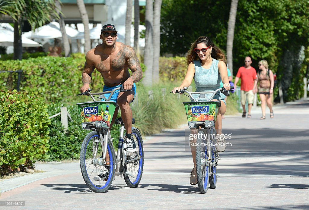 Kelly Brook is seen riding a bike with her boyfriend Dave McIntosh on February 03, 2014 in Miami, Florida.