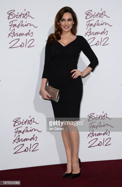 Kelly Brook poses in the awards room at the British Fashion Awards 2012 at The Savoy Hotel on November 27, 2012 in London, England.