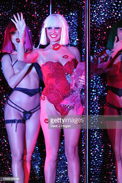 Kelly Brook poses onstage at her final show with Crazy Horse at The Forever Crazy Spiegel Tent on November 22 2012 in London England