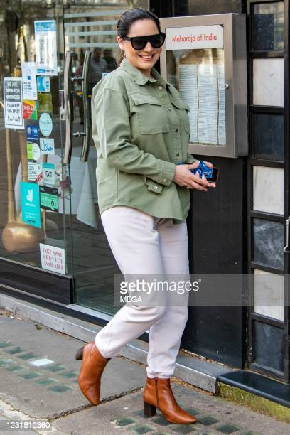 Kelly Brook seen arriving at Global Radio Studios on March 19, 2021 in London, England.