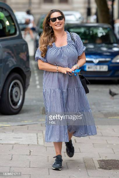 Kelly Brook seen arriving at the Global studios for her Heart Radio show on July 13, 2021 in London, England.