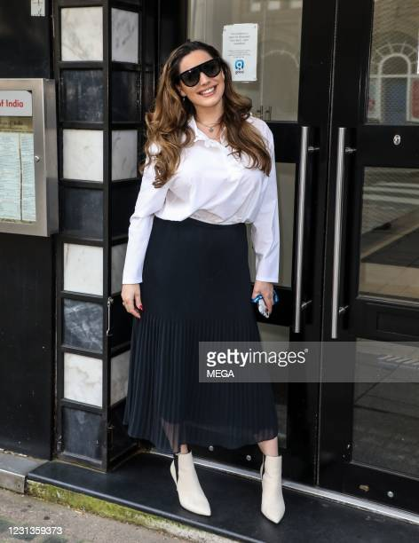 Kelly Brook seen arriving at the Global Studios on February 24, 2021 in London, England.