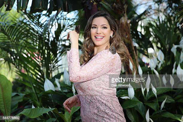 Kelly Brook takes part in a photocall at the Butterfly House during the press preview day of the Hampton Court Palace Flower Show on on July 4, 2016...