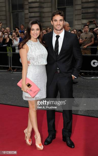 Kelly Brook with boyfriend Thom Evans attends the GQ Men of the Year Awards 2012 at The Royal Opera House on September 4 2012 in London England