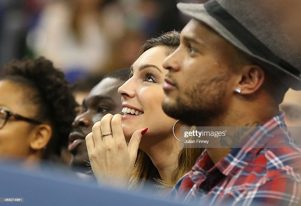 Kelly Brook with David McIntosh during the Eastern Conference NBA match between Brooklyn Nets and Atlanta Hawks at O2 Arena on January 16, 2014 in London, England.