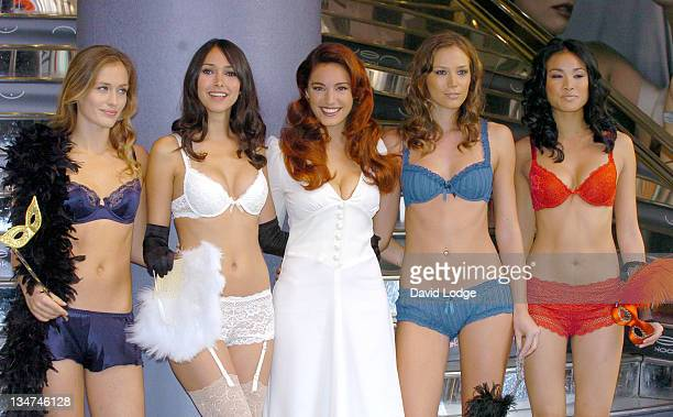 Kelly Brook with models during Kelly Brook Launches her New Lingerie Range for New Look Photocall at New Look in London Great Britain