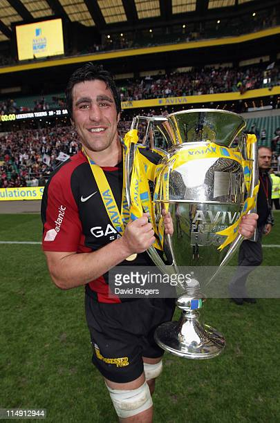 Kelly Brown of Saracens celebrates with the Aviva Premiership trophyduring the AVIVA Premiership Final between Leicester Tigers and Saracens at...