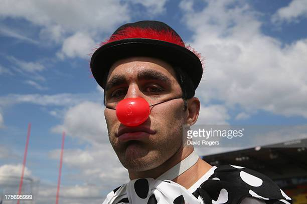Kelly Brown of Saracens dresses as a sad clown prior to the alternative team photograph wearing fancy dress at the photocall held at Allianz Park on...