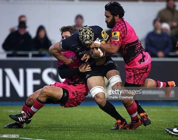 Kelly Brown of Saracens is held short of the line during the Aviva Premiership match between Saracens and London Welsh at Allianz Park on December 20...