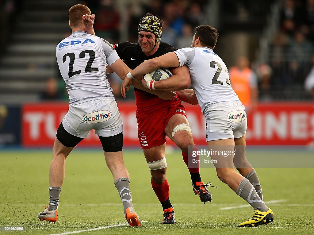 Kelly Brown of Saracens is tackled by Rory Clegg (L) and Vincent Martin (R) of Oyonnax during the European Rugby Champions Cup match between Saracens and Oyonnax at Allianz Park on December 19, 2015 in Barnet, England.