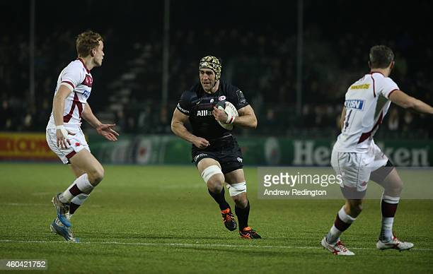 Kelly Brown of Saracens takes on the Sale Sharks defence during the European Rugby Champions Cup match between Saracens and Sale Sharks at Allianz...