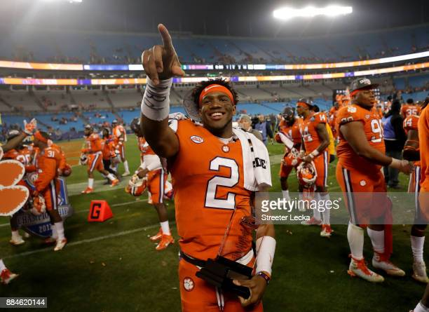 Kelly Bryant of the Clemson Tigers celebrates with the MVP trophy after defeating the Miami Hurricanes 383 in the ACC Football Championship at Bank...