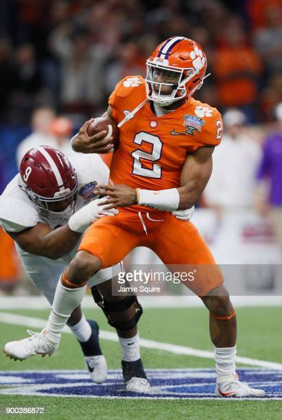 Kelly Bryant of the Clemson Tigers is pressured by Da'Shawn Hand of the Alabama Crimson Tide in the second half of the AllState Sugar Bowl at the...