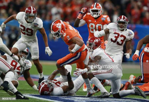 Kelly Bryant of the Clemson Tigers run is tackled by Rashaan Evans of the Alabama Crimson Tide and Deionte Thompson in the first half of the AllState...